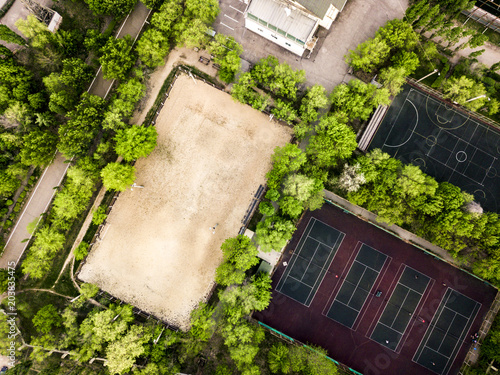 aerial view of summer sport camp courts and building in the forest Poster