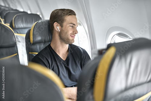 Handsome guy in airplane