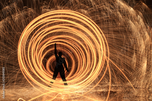 Unique Creative Light Painting With Fire and Tube Lighting Fototapeta