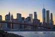 Illuminated Manhattan skyline during the sunset over the river Hudson. New York City, USA.
