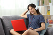 Happy teen watching videos online at home