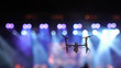 canvas print picture - Closeup silhouette of Drone flying for taking video of Concert crowd and Abstract blurred photo of spotlight in conference hall, musical and concert concept