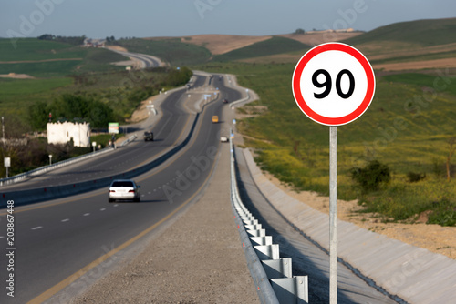 Fotografía  Speed limit 90, road sign on highway