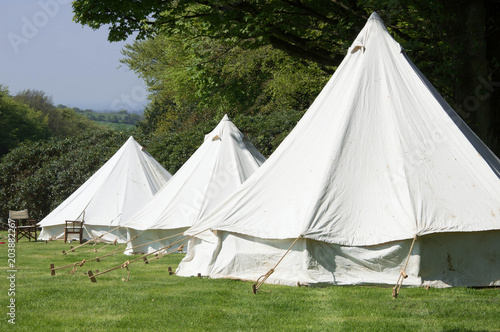 Old style double circular canvas tents in field & Old style double circular canvas tents in field - Buy this stock ...
