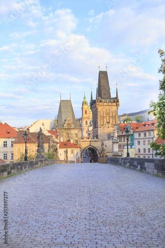 Ingelijste posters Praag Beautiful view of the Malostranska tower of Charles Bridge at dawn in Prague, Czech Republic