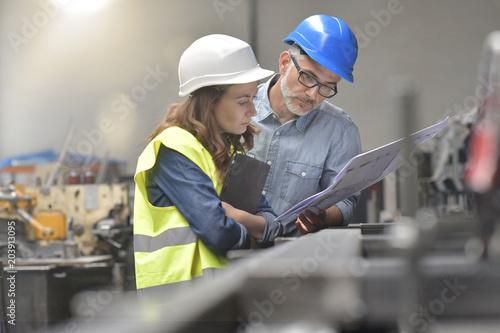 Metal industry manager and engineer meeting in factory Canvas Print
