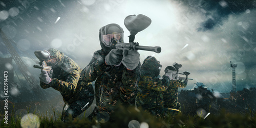 Paintball team in uniform and masks, extreme sport Tablou Canvas