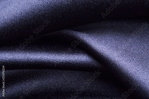 Tuinposter Stof Forms of dark fabric texture
