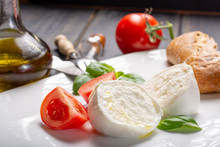 Traditional Italian Food - White Ball Mozzarella Buffalo Italian Soft Cheese With Cheese Knife, Tomato, Basil, Olive Oil