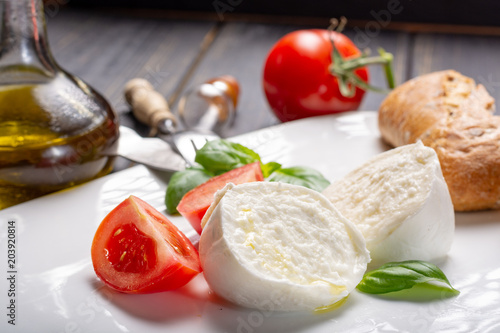 Fotomural Traditional italian food - white ball mozzarella buffalo Italian soft cheese wit
