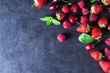Fresh Red Ripe Berries On Dark Grey Table