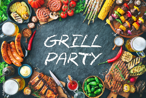 Aluminium Prints Grill / Barbecue Grilled meat and vegetables on rustic stone plate