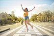 Girl jump in the street