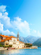 Harbour and boats in sunny day at Boka Kotor bay (Boka Kotorska), Montenegro, Europe
