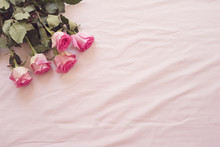 Floral Frame With Stunning Pink Roses On Pink Bed Sheets In The Bedroom. Copy Space. Wedding, Gift Card, Valentine's Day Or Mother's Day Background
