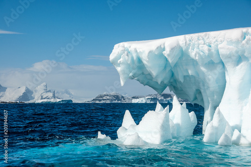 Ingelijste posters Antarctica Jaws of Ice - Iceberg surrounded by turqouise sea, Antarctica