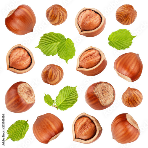Fotografia Hazelnuts with leaves isolated on white background. Collection