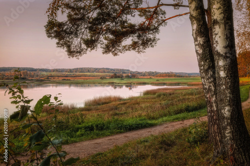 Foto op Aluminium Diepbruine pink sunset by the lake
