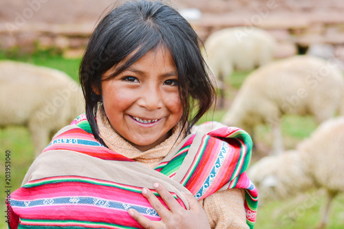 Pinturas sobre lienzo  Happy native american girl wearing ethnic aymara cloth
