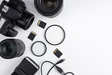 Top View Of Dslr Camera, Lenses, Photo Equipment And Copy Space Over White Table