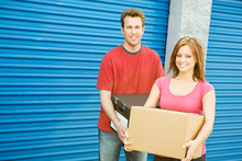 Storage: Couple Carrying Boxes...