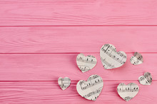 Paper Hearts With Notes And Copy Space. Heart Shaped Paper Figures With Music Notes On Wooden Background.