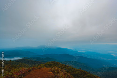 Foto op Canvas Donkergrijs high mountains peaks range clouds in fog scenery landscape national park view outdoor at Chiang Rai, Chiang Mai Province, Thailand