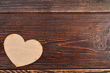 Wooden Heart On Dark Textured Background. Blank Plywood Heart Decoration And Copy Space. Valentines Holiday Greeting Background.