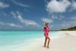 sexy woman with blond hair n luxurious bikini relaxing on Maldive island