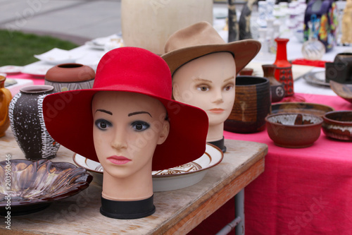 Foto  Scene from Flea market where people sell and buy used hats toys, clothes, pictur