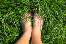 Top View Of Female Feet Immers...