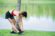 Asian sporty woman stretching body breathing fresh air in the park,Thailand people,Fitness and exercise concept,Jogging in the park