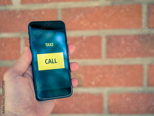 Taxi app on mobile phone  One click to order or call a cab