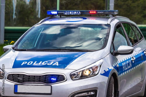 Fotografia close up on Policja (Police) sign on car. Poland
