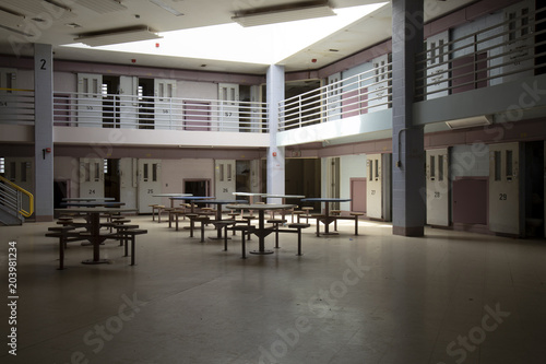 Photo  Abandoned jail common room in cell block