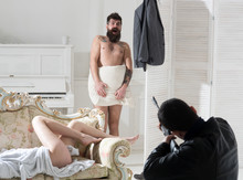Man Arriving Home While Wife C...