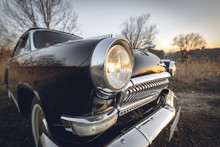 Classic Vintage Retro Black Car Closeup View From Bumper And Lamp On Sunset