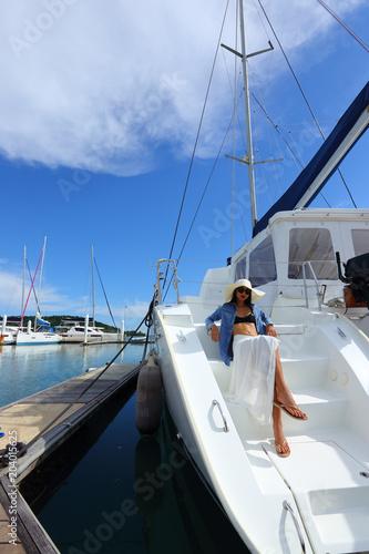 Papiers peints Nautique motorise Mix Race Tanned skin Woman walk along Luxury Yachts in Marina Bay Club