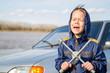 happy boy with key for repairing car wheels
