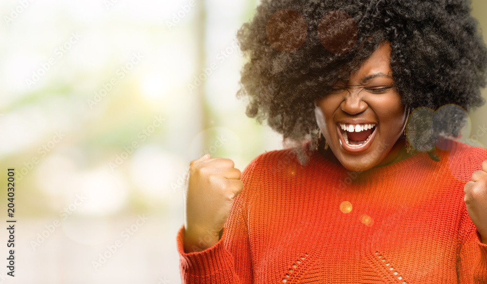 Fototapety, obrazy: Beautiful african woman happy and excited celebrating victory expressing big success, power, energy and positive emotions. Celebrates new job joyful, outdoor