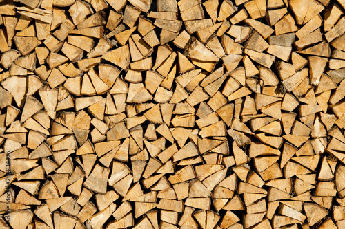 Keuken foto achterwand Brandhout textuur Dry chopped firewood logs ready for winter as background or texture.