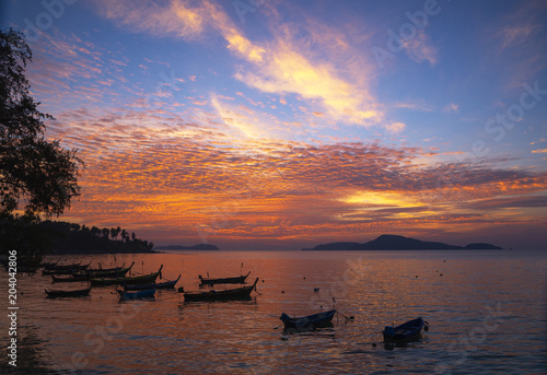 Foto op Canvas Ochtendgloren Beautiful sky during sunrise at Rawai beach