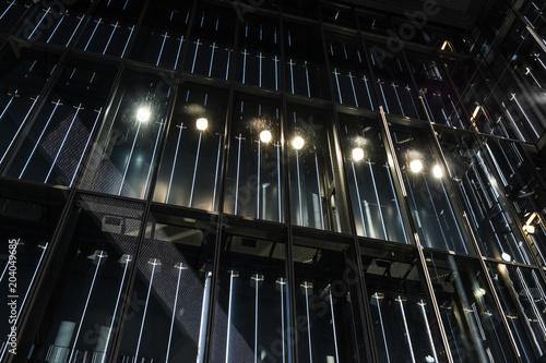 Fényképezés  The modern glass architecture with illumination at night
