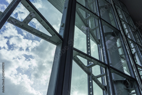 The glass architecture in city against a sky Wallpaper Mural