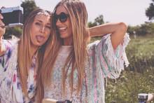 Twin Sisters Making A Selfie W...