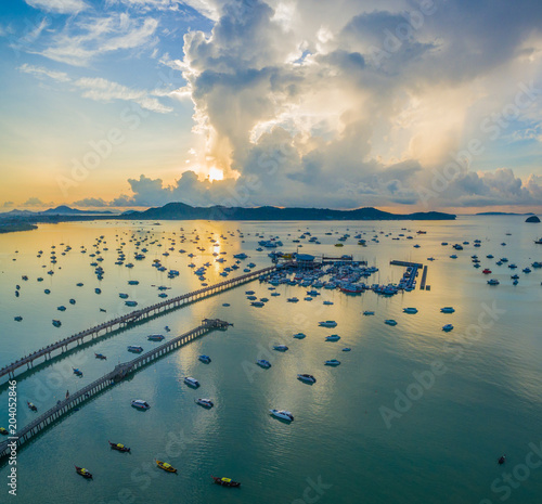 Staande foto Poort aerial photography cloudy above Chalong pier