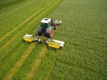 Aerial View Of A Tractor Mowin...