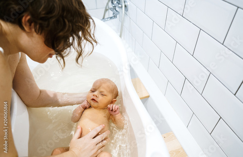 Canvas The first bathing of the baby in the bathroom