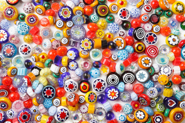 Collection of colorful glass beads. Colored Venetian, Murano glass, millefiori.