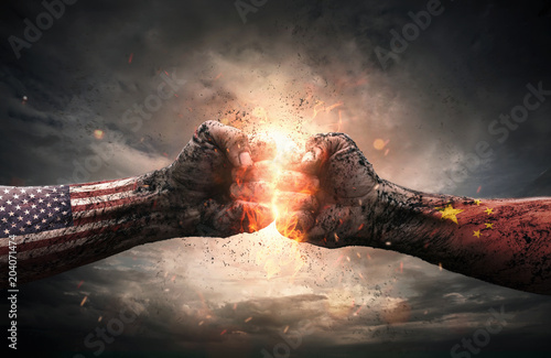 Obraz na plátně Conflict, close up of two fists hitting each other over dramatic background with